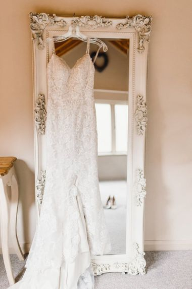 Lace brides dress for traditional celebration with gypsophila bouquets