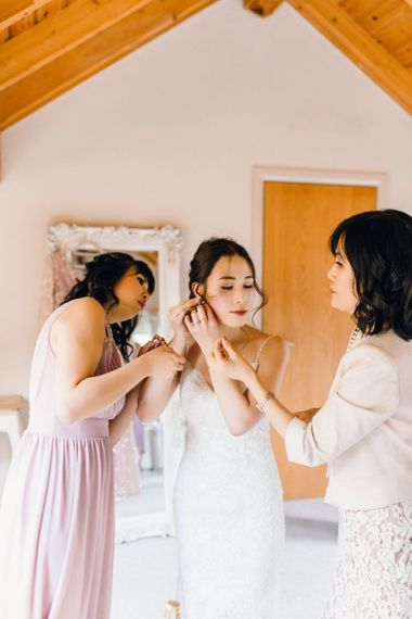 Bride and her bridal party getting ready for the ceremony