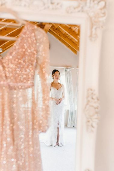Brides lace delicate ceremony dress and gold glitter evening gown