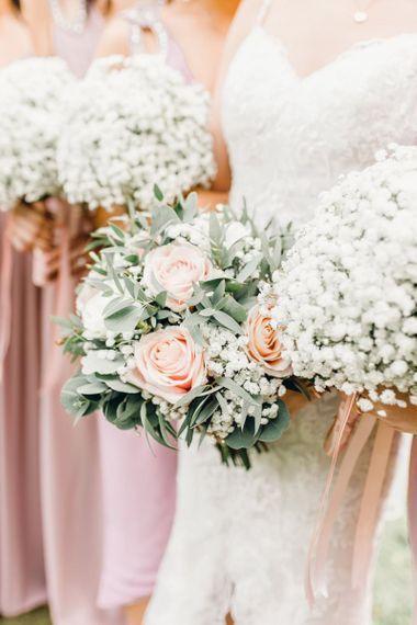 Dusky pink rose bridal bouquet with gypsophila bridesmaid bouquets