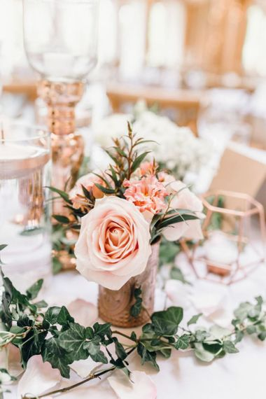 Pink roses for wedding reception centrepieces with rose gold detailing and gypsophila bouquets