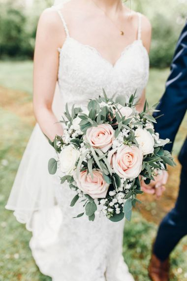 Pink and white rose with gypsophila foliage bouquets