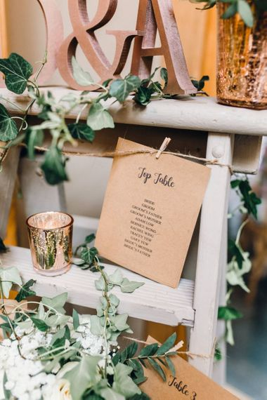 Rustic styled table plan with pegs and rose gold detailing
