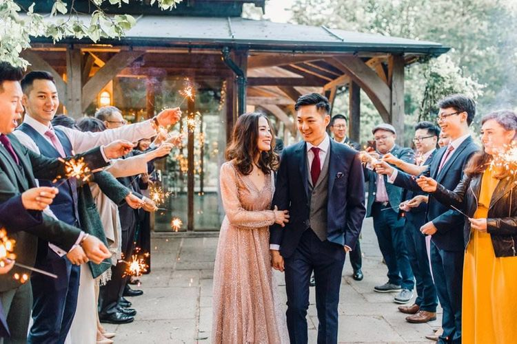 Sparkler exit with bride wearing a beautiful gold glitter evening gown