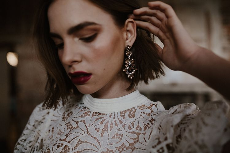 Bridal Accessories | Earrings | Bride in Cap Sleeve & High Neck Lace Bridal Gown | Deep Florals Wedding Inspiration at The Grange at Northington Planned & Styled by Wed & Bash | Sara Lincoln Photography