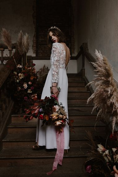 Bride in Lace Long Sleeve Bodice & Fitted Skirt With Slit Bridal Gown | Floral Design by Jenni Bloom Flowers | Deep Florals Wedding Inspiration at The Grange at Northington Planned & Styled by Wed & Bash | Sara Lincoln Photography