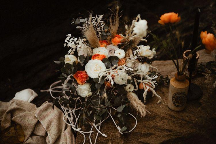White and orange ranunculus wedding bouquet