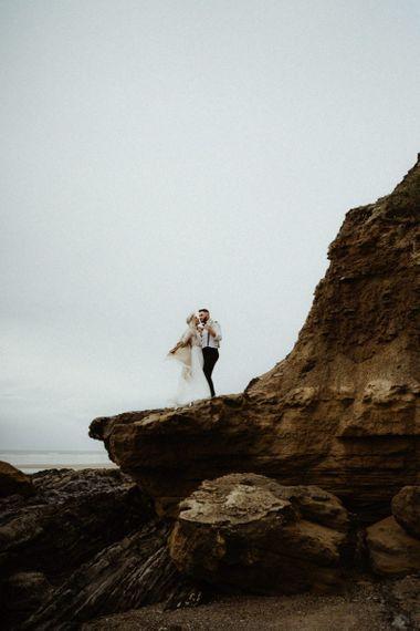 Bride and groom portrait on the beach at Devon elopement