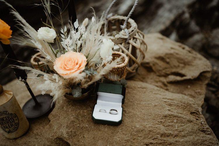 Wedding bands on a rock at Devon elopement