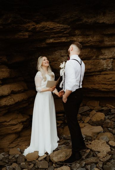 Boho bride reading her vows at Devon elopement