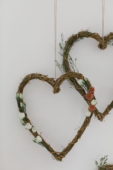 Floral heart wreaths with wax flowers, white lisianthus and mini chrysanthemums