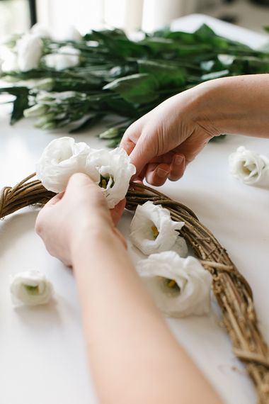 DIY flower wreath using rattan hearts, twine and white lisianthus