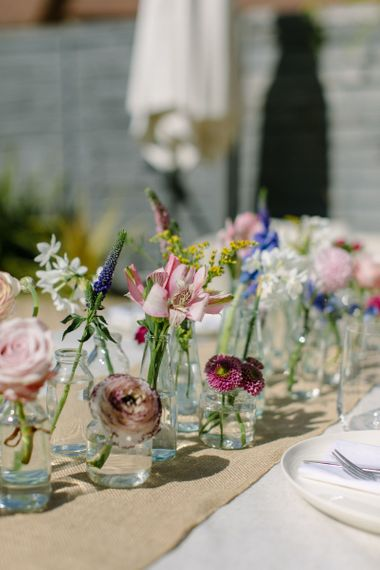 Floral wedding centrepiece using antique pink roses, narcissi and ranunculus