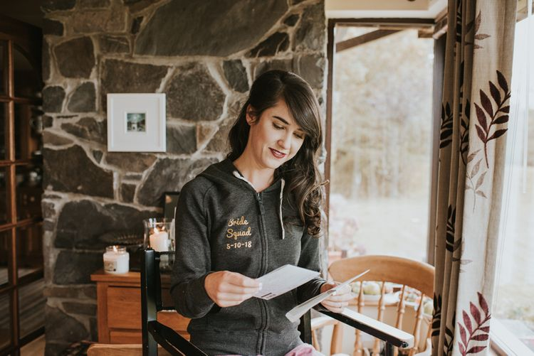 Bride on the Wedding Morning Wearing a Personalised Bride Squad Hoodie