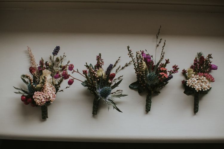 Buttonholes with Deep Red and Green Flowers