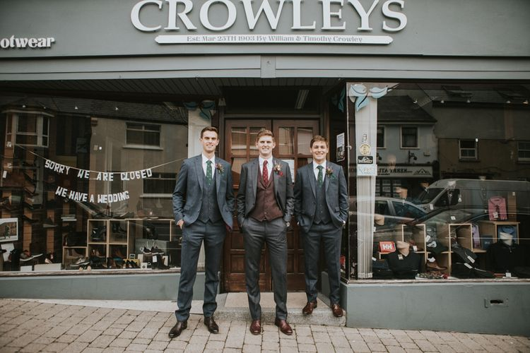 Groomsmen Standing Outside Crowleys - The Family Business