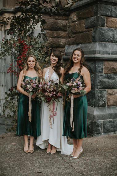 Bridal Party Portrait with Bridesmaids in Emerald Green Dresses and Bride in Elbeth Gillis Wedding Dress