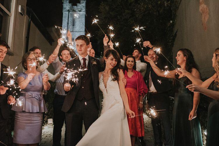 Sparkler Moment with Bride in Elbeth Gillis Wedding Dress and Groom in  Tweed Suit