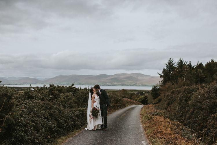 Bride in Elbeth Gillis Wedding Dress and Groom in  Tweed Suit