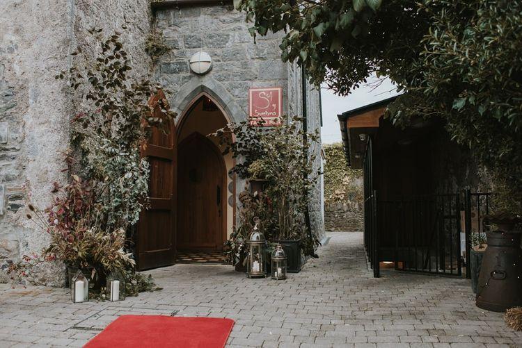 Deep Red and Green Doorway Wedding Flower Arrangements