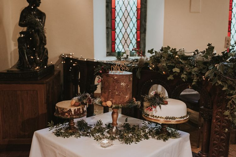 Cake Table with Homemade Wedding Cakes Decorated with Foliage