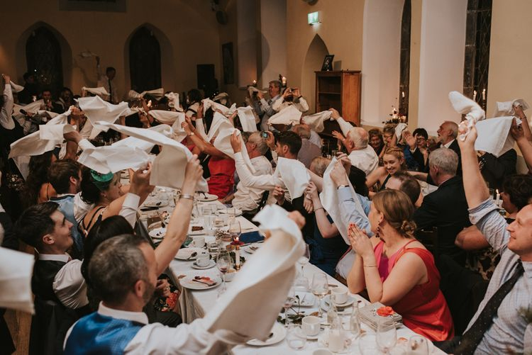 Wedding Guests Waving Their Napkins