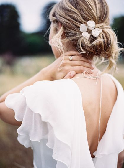 Messy Bun Bridal Hairstyle with Mother of Pearl Hair Accessory | Bride in Lace Cherry Williams London Gown | Elegant Summer Inspiration at St Giles House, Dorset by Jessica Roberts Design   Imogen Xiana Photography