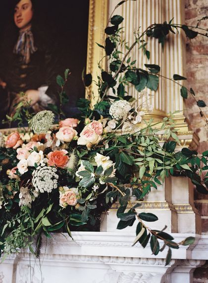 Living Coral, White & Greenery Fireplace Mantel Wedding Flowers | Elegant Summer Inspiration at St Giles House, Dorset by Jessica Roberts Design   Imogen Xiana Photography