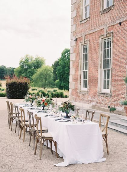 Outdoor Tablescape with Living Coral, White & Greenery Floral Centrepieces | Elegant Summer Inspiration at St Giles House, Dorset by Jessica Roberts Design   Imogen Xiana Photography