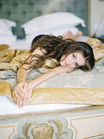 Wedding Morning Bridal Preparations with Bride Laying on a Bed
