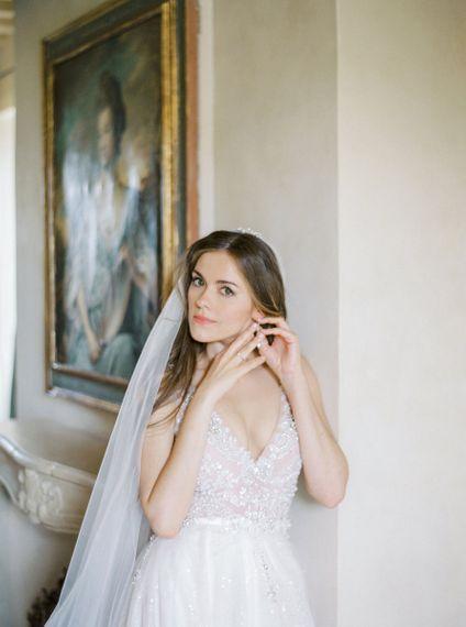 Beautiful Bride Putting on Her Wedding Day Earrings