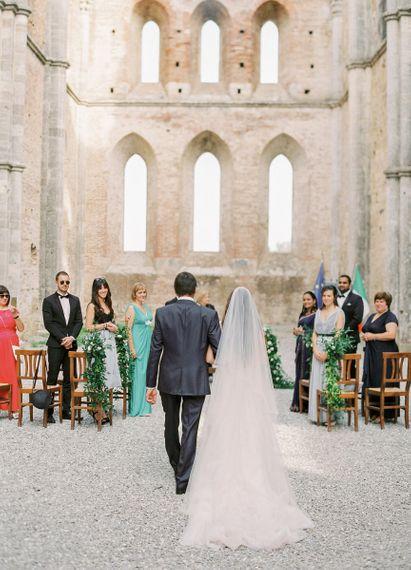 Wedding Ceremony Bridal Entrance with Long Veil