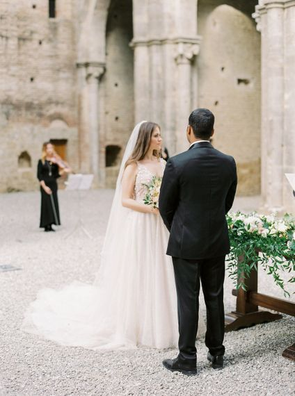 Bride and Groom Exchanging Vows at Their Open Air Church Wedding Ceremony