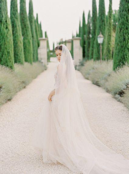 Bride in a Rara Avis Wedding Dress with Long Tulle Wedding Veil