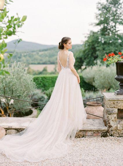 Bride in a Backless Rara Avis Wedding Dress with Tulle Skirt