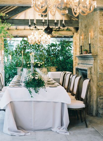 Intimate Wedding Breakfast with Greenery Runner and Chandelier Lights