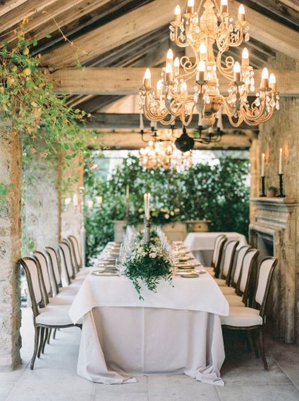 Elegant Wedding Reception with Chandeliers, Candle Light and Floral Centrepiece