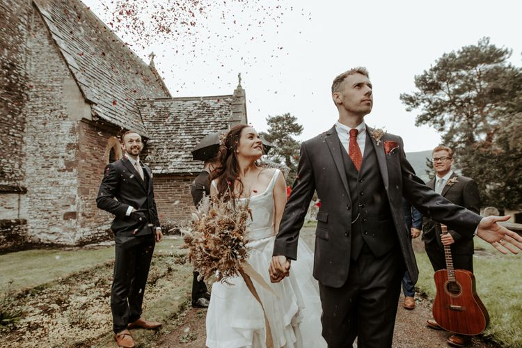 Bride and groom in the churchyard at September 2020 wedding