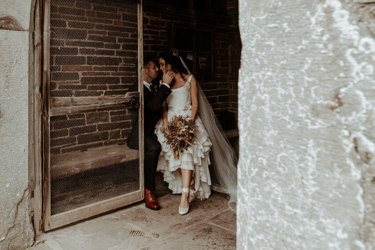 Bride in high low Vivienne Westwood inspired wedding dress