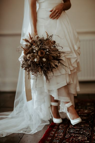 Dried flower wedding bouquet and high and low wedding dress