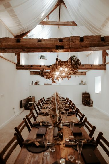 Intimate wedding reception with Autumnal wedding decor for September 2020 wedding