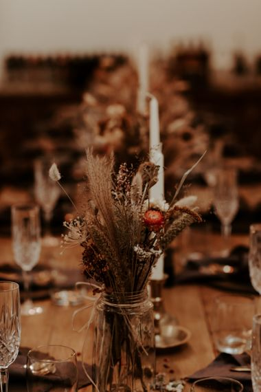 Dried flowers and grasses in jars for September 2020 wedding