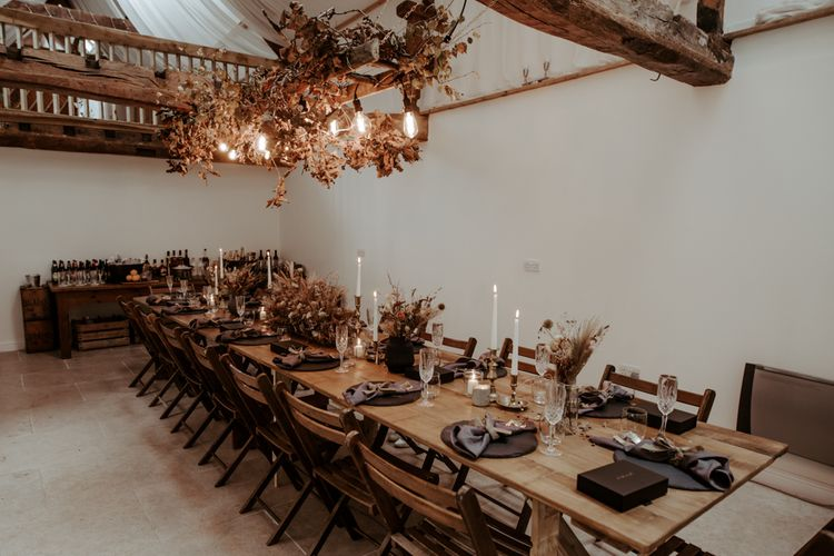 Intimate wedding reception  with Autumnal wedding decor and festoon lights