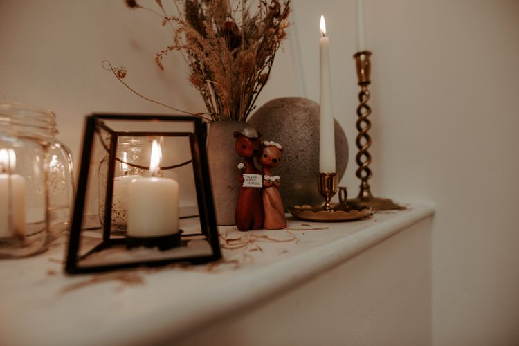 Candles and wooden figures for September 2020 wedding