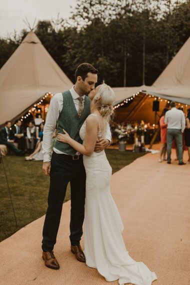 Bride and groom outside teepee for wedding