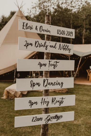 Wooden order of the day wedding sign at Teepee for wedding