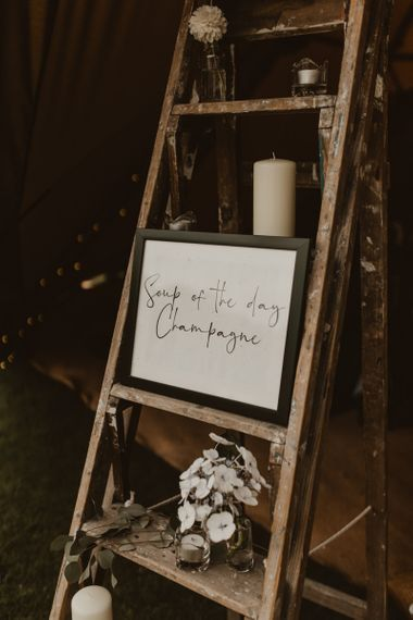 Wedding sign and stepladder decor at Teepee for wedding reception