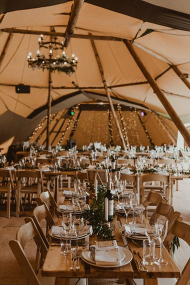 Teepee for wedding reception with foliage decor