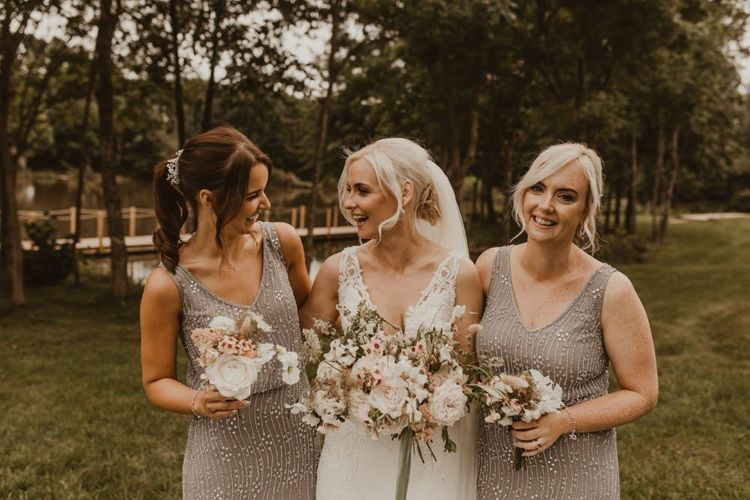 Bridesmaids in grey beaded dresses