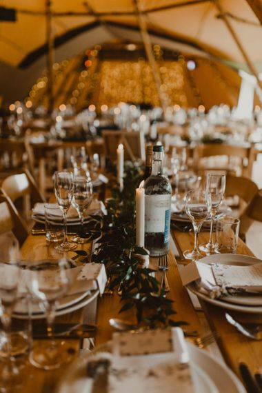 Wedding table decor with foliage and candles